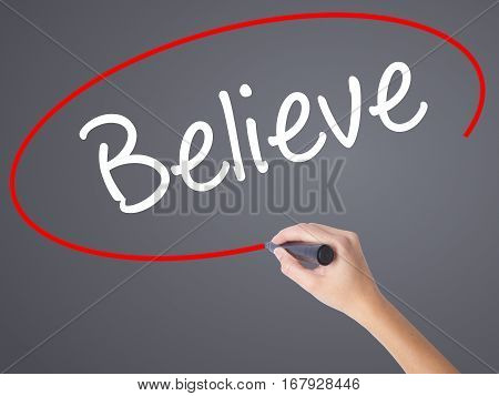 Woman Hand Writing Believe With Black Marker On Visual Screen