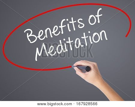 Woman Hand Writing Benefits Of Meditation With Black Marker On Visual Screen.