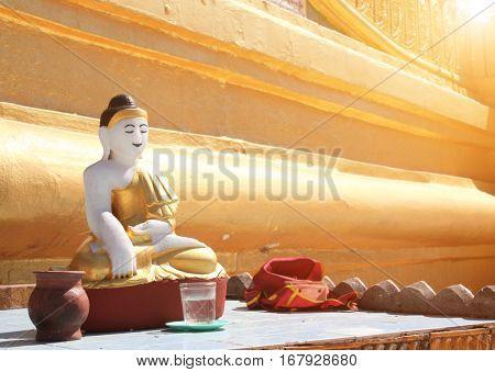 Old stone statue of meditating Buddha, Shwemawdaw Paya temple (Golden Temple), Bago, Bago Region, Myanmar (Burma)