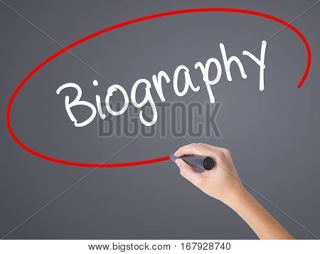 Woman Hand Writing Biography  With Black Marker On Visual Screen