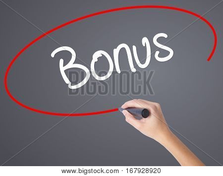 Woman Hand Writing Bonus With Black Marker On Visual Screen