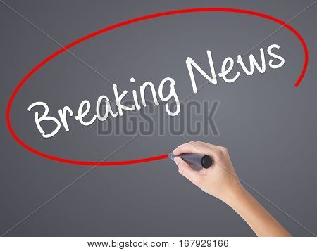 Woman Hand Writing Breaking News With Black Marker On Visual Screen