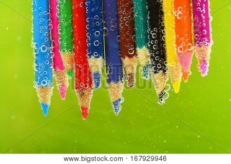 Colored Pencils In Sparkling Water