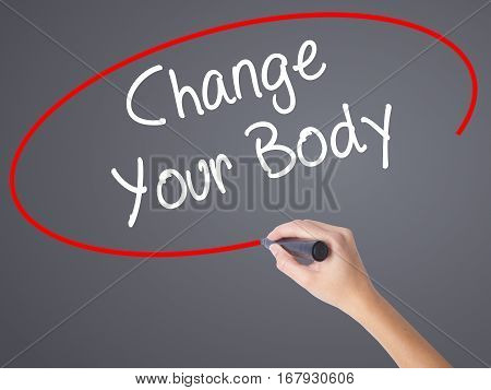 Woman Hand Writing Change Your Body With Black Marker On Visual Screen.