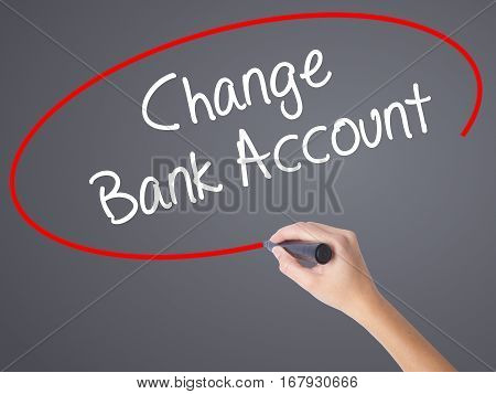 Woman Hand Writing Change Bank Account With Black Marker On Visual Screen