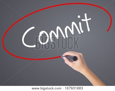 Woman Hand Writing Commit With Black Marker On Visual Screen