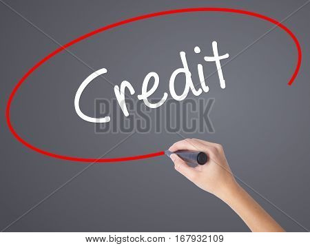 Woman Hand Writing Credit With Black Marker On Visual Screen