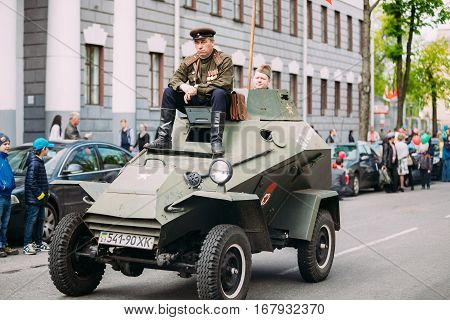 Gomel, Belarus - May 9, 2015: Parade Of Russian Soviet Military Warfare Of WW2 Time With Re-Enactors Dressed As Red Army Soldiers. BA-64 Is A Small Lightly Armoured Soviet Scout Car