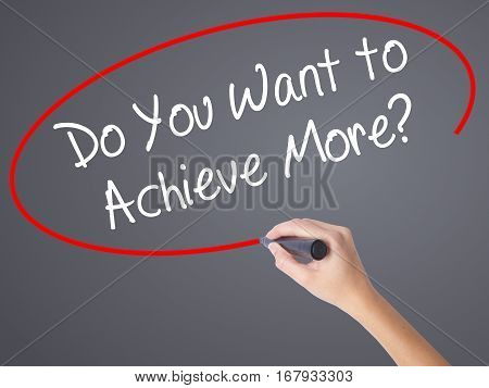 Woman Hand Writing Do You Want To Achieve More? With Black Marker On Visual Screen