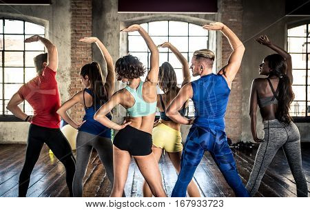 Professional dancer class in the gym follow the lesson