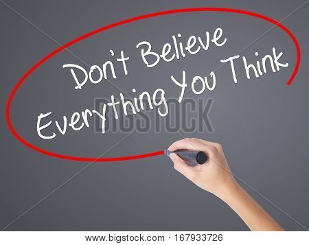 Woman Hand Writing Don't Believe Everything You Think With Black Marker On Visual Screen.