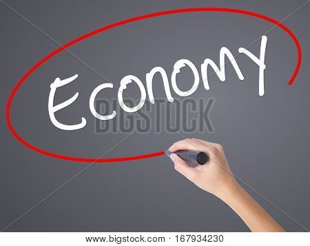 Woman Hand Writing Economy With Black Marker On Visual Screen.