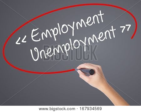 Woman Hand Writing Employment - Unemployment With Black Marker On Visual Screen.