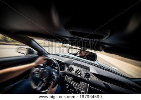 Man driving his sport car. inside cockpit view