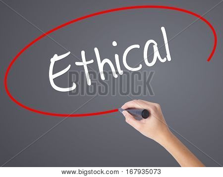 Woman Hand Writing Ethical  With Black Marker On Visual Screen