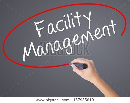 Woman Hand Writing Facility Management With Black Marker On Visual Screen