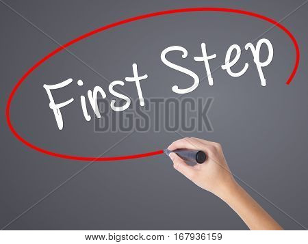 Woman Hand Writing First Step  With Black Marker On Visual Screen