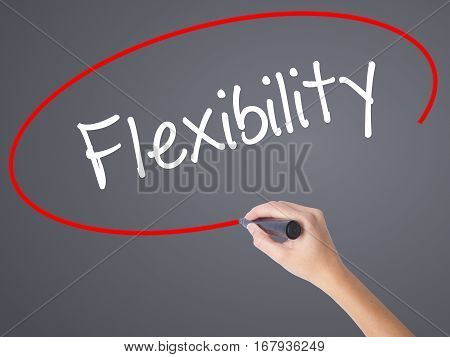 Woman Hand Writing Flexibility With Black Marker On Visual Screen