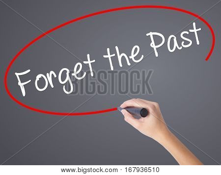 Woman Hand Writing Forget The Past With Black Marker On Visual Screen