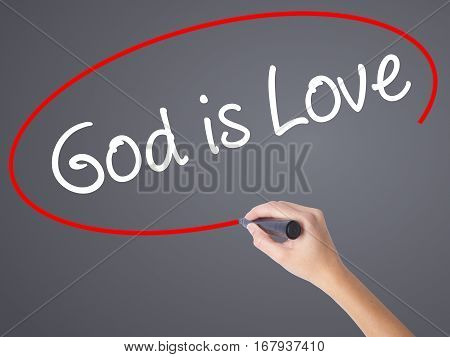 Woman Hand Writing God Is Love With Black Marker On Visual Screen
