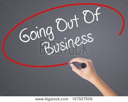 Woman Hand Writing Going Out Of Business With Black Marker On Visual Screen