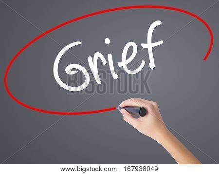 Woman Hand Writing Grief With Black Marker On Visual Screen