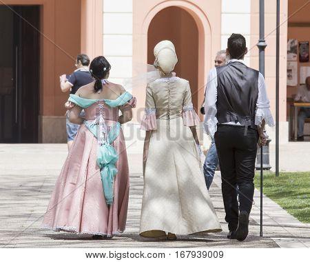 CAGLIARI, ITALY - June 1, 2014: Sunday at La Grande Jatte public gardens - Sardinia - group of people parading in Victorian costumes