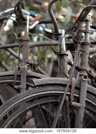 ABSTRACT SHOT OF OLD RUSTY BICYCLE PARTS