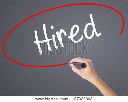 Woman Hand Writing Hired With Black Marker On Visual Screen