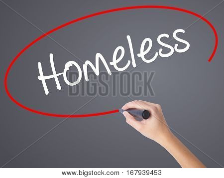 Woman Hand Writing Homeless With Black Marker On Visual Screen.