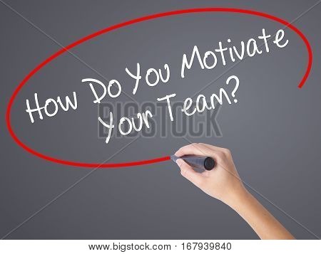Woman Hand Writing How Do You Motivate Your Team? With Black Marker On Visual Screen