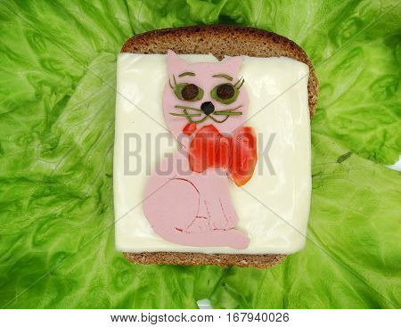 creative sandwich with cheese and salame cat shape