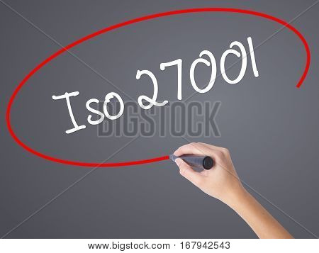 Woman Hand Writing Iso 27001  With Black Marker On Visual Screen