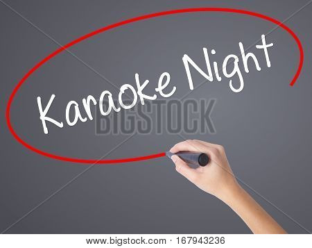 Woman Hand Writing Karaoke Night With Black Marker On Visual Screen