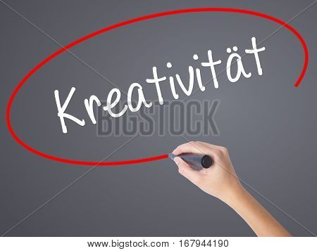 Woman Hand Writing Kreativitat (creativity In German)   With Black Marker On Visual Screen