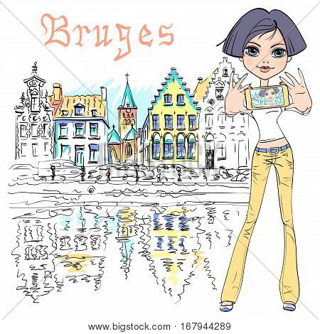 Cute hipster girl makes selfie, scenic city view of Bruges canal with beautiful medieval houses on the background, Belgium.