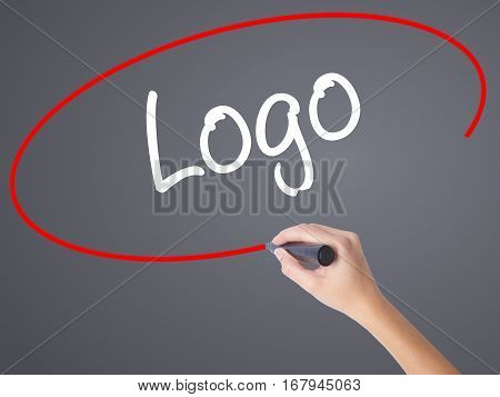 Woman Hand Writing Logo  With Black Marker On Visual Screen
