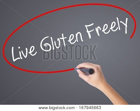 Woman Hand Writing Live Gluten Freely With Black Marker On Visual Screen.