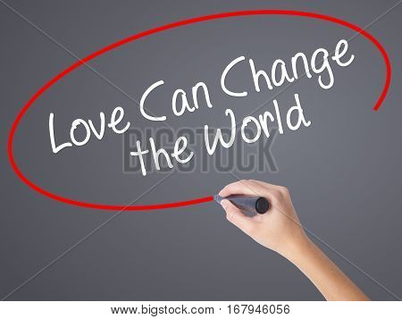 Woman Hand Writing Love Can Change The World With Black Marker On Visual Screen