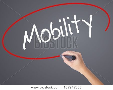 Woman Hand Writing Mobility With Black Marker On Visual Screen