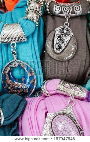 The decoration of stone and metal on the viscose scarf