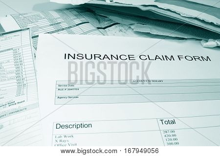 health insurance claim form with assorted medical bills