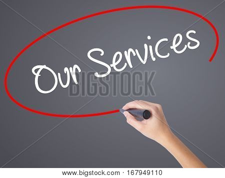 Woman Hand Writing Our Services With Black Marker On Visual Screen