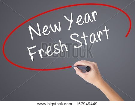 Woman Hand Writing New Year Fresh Start With Black Marker On Visual Screen