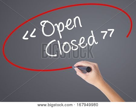 Woman Hand Writing Open - Closed With Black Marker On Visual Screen