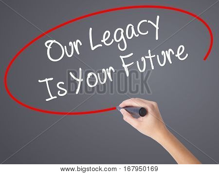 Woman Hand Writing Our Legacy Is Your Future  With Black Marker On Visual Screen