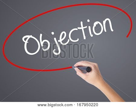 Woman Hand Writing Objection With Black Marker On Visual Screen