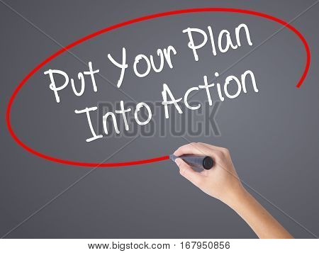 Woman Hand Writing Put Your Plan Into Action With Black Marker On Visual Screen