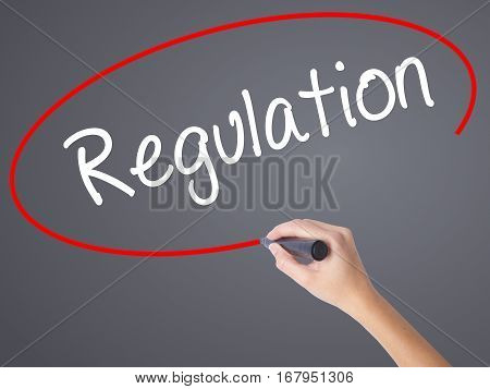 Woman Hand Writing Regulation  With Black Marker On Visual Screen