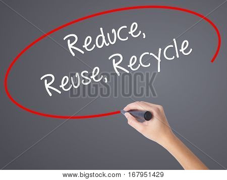 Woman Hand Writing Reduce Reuse Recycle With Black Marker On Visual Screen.
